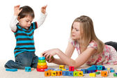 Playing on the carpet with blocks — Stock Photo