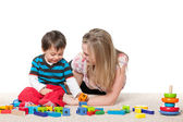 Playing on the carpet mother and a little son — Stock Photo