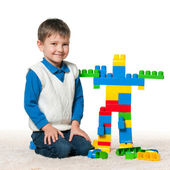 Little boy is playing with meccano — Stock Photo