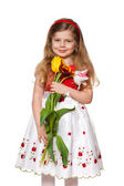 Pretty little girl with flowers — Stock Photo
