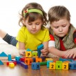 Two children are playing on the floor — Stock Photo #9818634