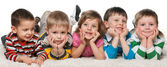 Five children lying on the carpet — Stock Photo