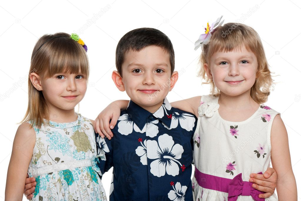 Three children are standing together isolated on the white background — Stock Photo #9818541