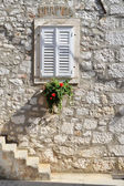 Outer solar house with stairs and window with flowers in Croatia — Stock Photo