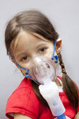 Little girl with nebulizer — Stock Photo