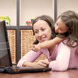 Mother and her daughter in front of laptop — Stock Photo