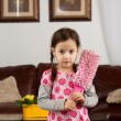 Little girl  with feather duster — Stock Photo