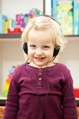 Happy little girl with headphone — Stock Photo