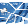 Credit card cut into pieces - Stock Photo