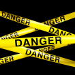 Danger caution tape - Stock Photo