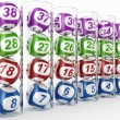 Lottery balls in glass tubes - Stock Photo