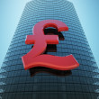 Skyscraper with red pound sign — Stockfoto