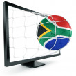 Soccer ball coming out of monitor — Stock fotografie