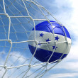 Soccerball in net - Photo