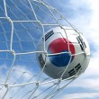 Soccerball in net — Stock fotografie