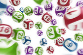 Flying lottery balls — Stock Photo