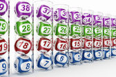Lottery balls in glass tubes — Stock Photo