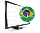 モニターから出てくるサッカー ボール — ストック写真