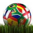 Soccerball with flags in grass — Stock Photo #8292237