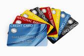 Tarjeta de crédito hacia fuera — Foto de Stock