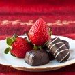 Strawberries and Chocolates on a Plate — Stock Photo
