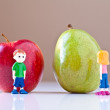 Girl and Boy Arguing over Healthy Food Choices (Pear and Apple) - Stock Photo