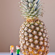 Girl and Boy Discussing Healthy Nutrition (Pineapple) — Stock Photo