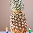 Постер, плакат: Girl and Boy Overwhelmed by Nutrition Choices Pineapple