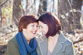 Portrait of Laughing Adult Mother and Daughter — Stock Photo