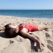 Little Girl Relaxing on the Beach Covered in Sand — Stock Photo #9132644