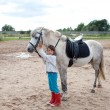 Little girl ready for a horseback riding lesson — Stock Photo