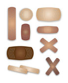 Flesh colored band-aids — Stock Vector