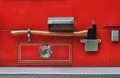 Axe on a fire truck — Stock Photo