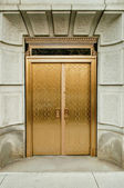 Golden doors — Stock Photo