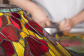 Man is making tiffany lamps — Stock Photo