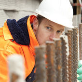 Manual worker looking at construction, road construction — Stock Photo