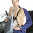 Mechanic Holding Cardboard Boxes And Oil Can — Stock Photo