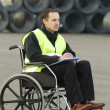Disabled Supervisor Updating His Checklist — Stock Photo