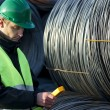 Supervisor Looking At Geiger Counter With Cable Wire Rolls — Stock Photo