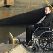 Disabled Man On Wheelchair Outdoors - Stock Photo