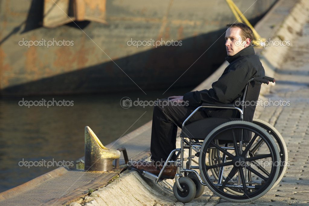 Relaxed disabled man spending some time alone on wheelchair outdoors — Stock Photo #8964475