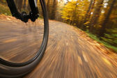 Bicycle riding, low angle motion blur — Stock Photo