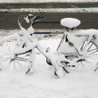 图库照片: Snow covered bicycle