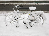 Snow covered bicycle — Stock Photo