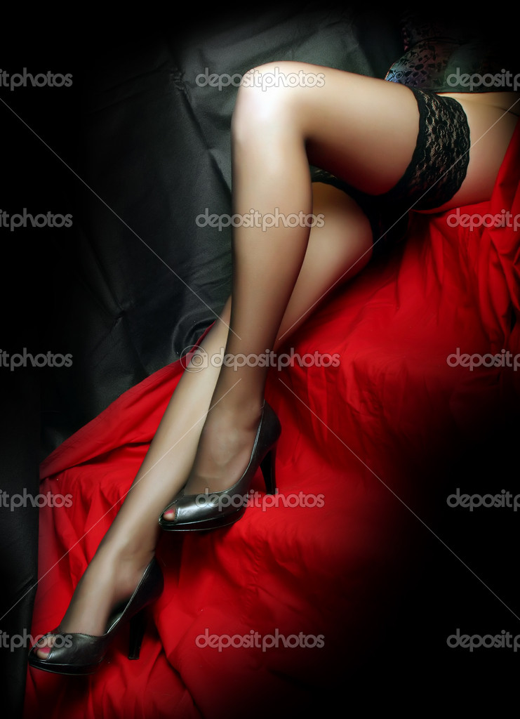 Woman legs on the red wrap — Stock Photo #8176348