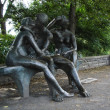 Lover's bench statue - Lea Vivot - Montreal Quebec Canada - Stock Photo