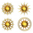 Four Metallic Sun Symbols - Stock Photo