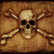 Skull and Crossbones on Paerchment - Stock Photo