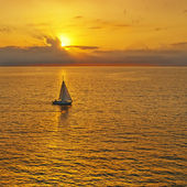 Golden sunset and yacht. — Stock Photo