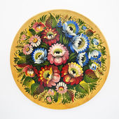 Floral decorative folk pattern on a wood dish on a white backgro — Stock Photo